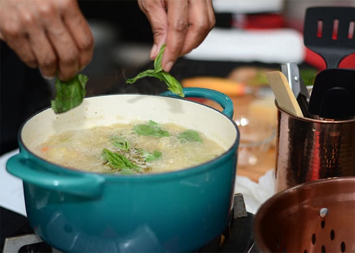 image of boiling soup in a blue pot